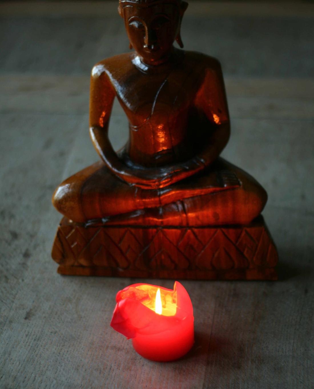 Candle and Buddha